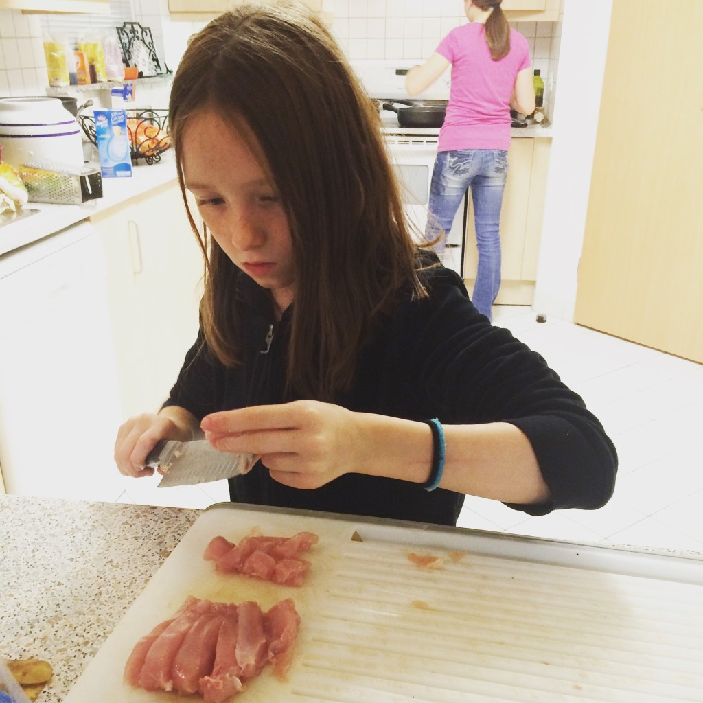 My daughter Meredith (10) chopping chicken for Chicken fingers.