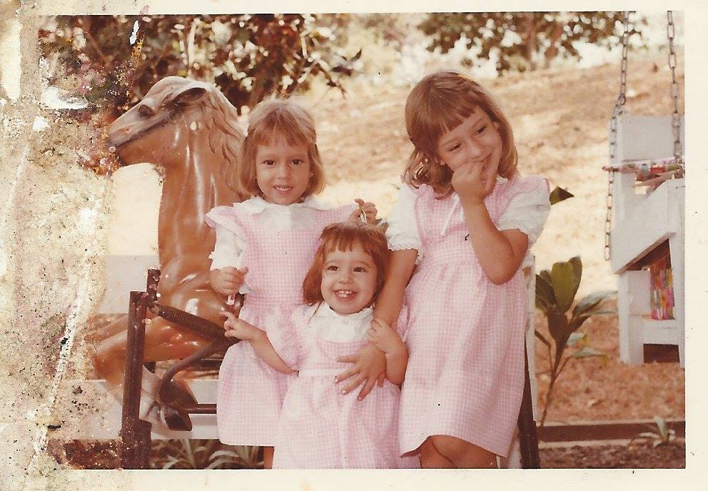 Me and two of my three sisters. I'm on the right.